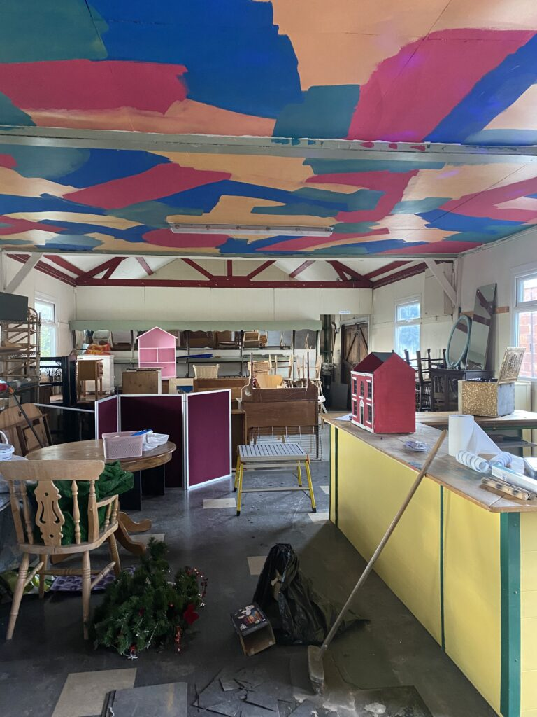 very brightly coloured ceiling in our hut